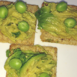 Avocado on Rosemary Crackers with Fresh Peas