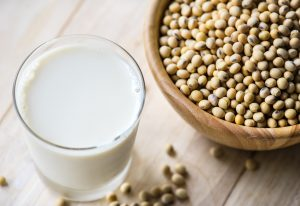glass of milk and bowl of legumes