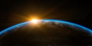 The sun is rising over the earth