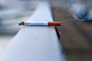 cigarette burning on railing