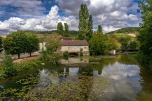 French countryside with home and trees