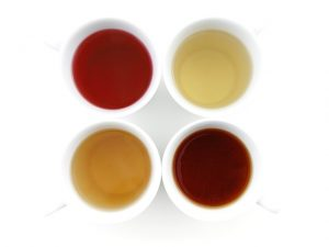 4 mugs of tea, white, red, black and green
