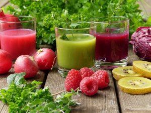 3 glasses of juice raspberries, lemon, and parsley