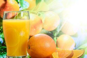 Oranges and glass of orange juice