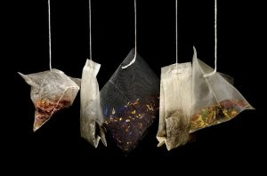 5 different tea bags hanging from strings