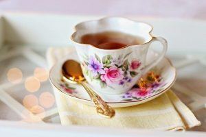 flowered tea cup and saucer with tea
